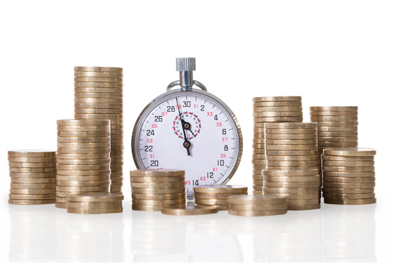 Stopwatch and coin stacks isolated over white background