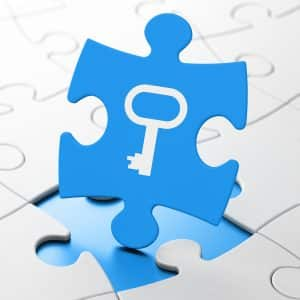 Protection concept: Key on Blue puzzle pieces background, 3D rendering